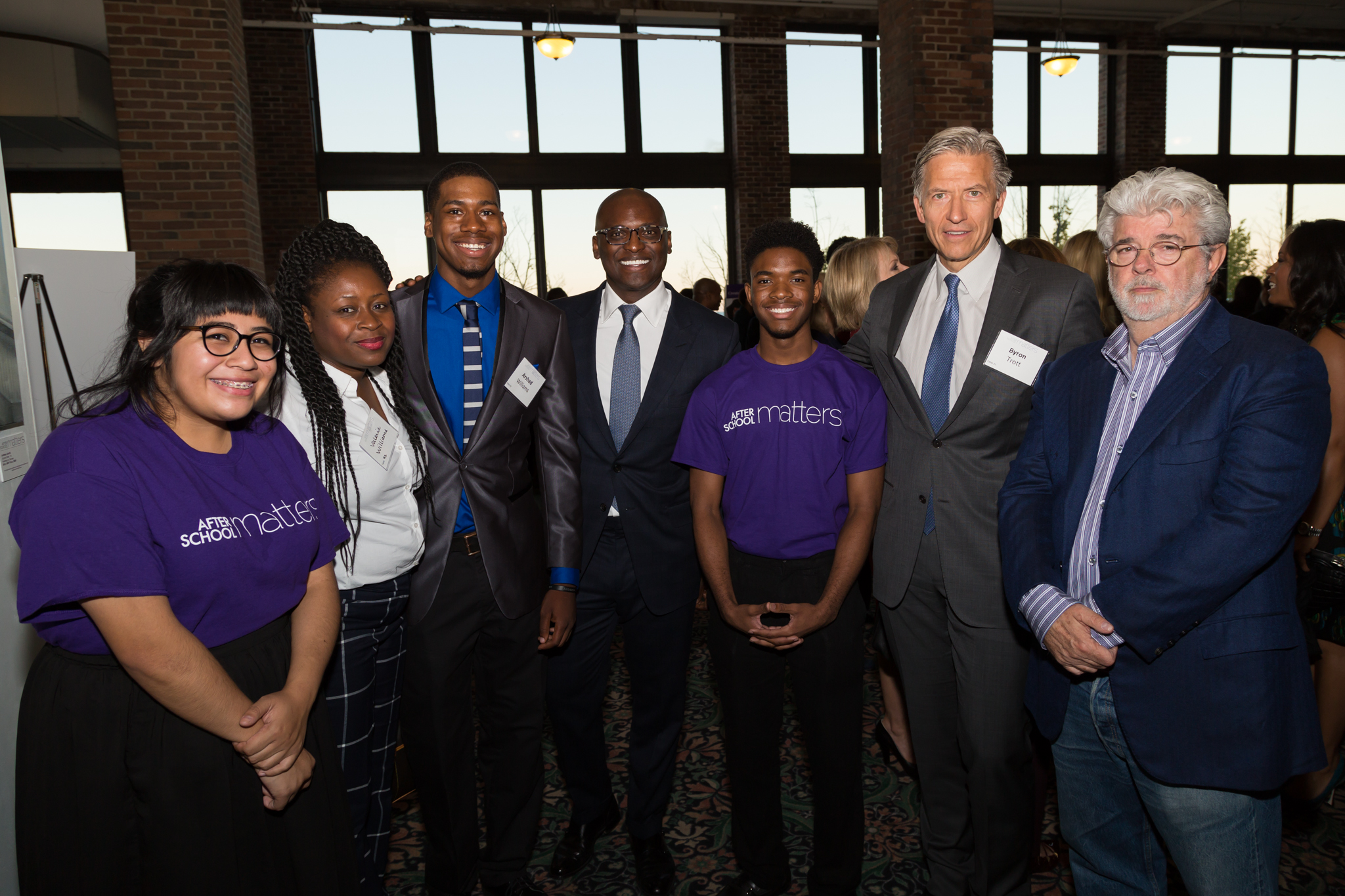 <p>After School Matters teens Alejandra and Alex alongside guests (from left) Valerie and alumnus Arshad Williams, Board Vice Chair Robbie Robinson, and Gala Chairs Byron Trott and George Lucas at the reception of the After School Matters Annual Gala on September 21, 2015 at Chicago's Navy Pier. Photo credit: Juan Martinez</p>