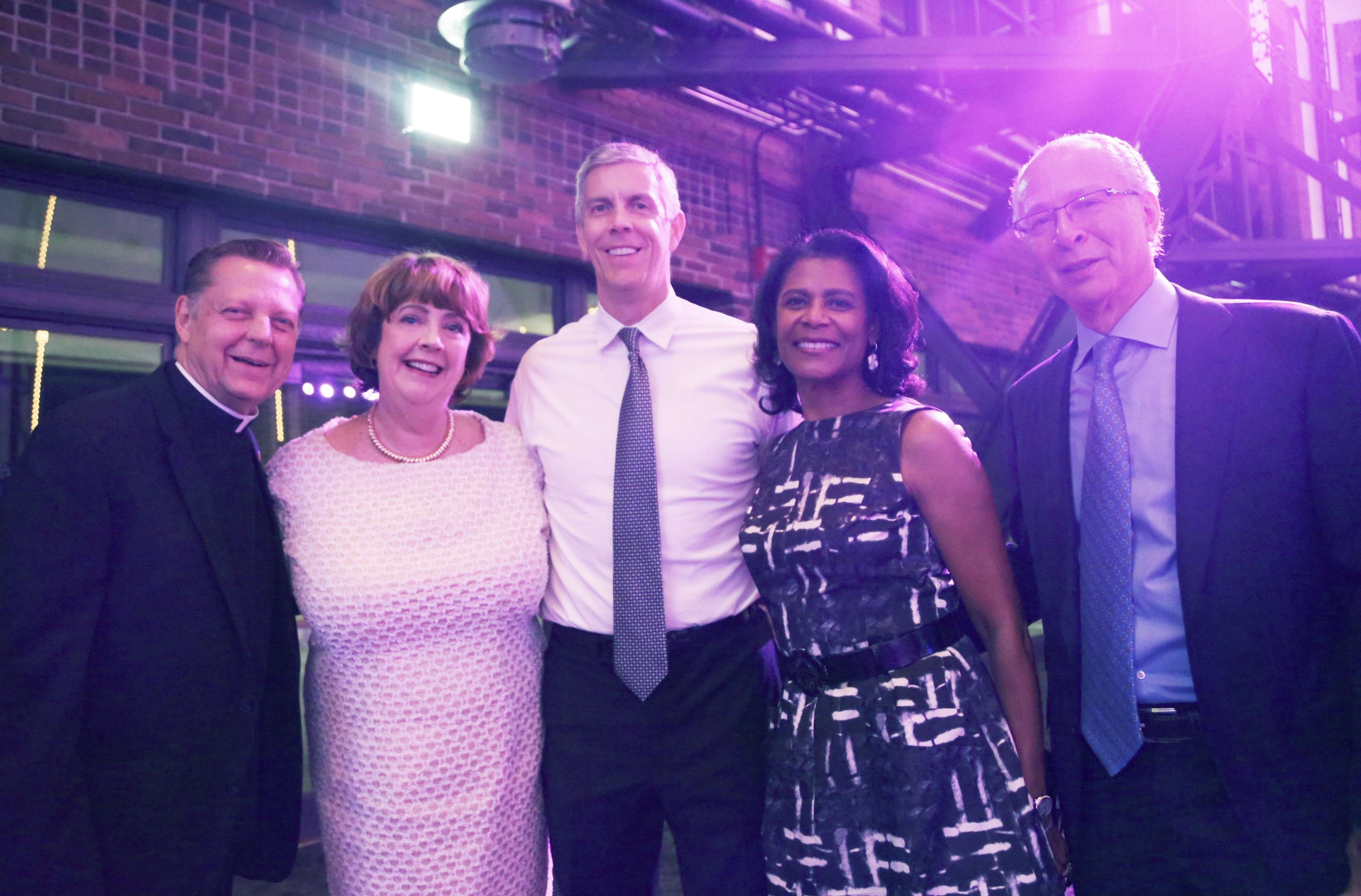<p>Youth advocates Fr. Michael Pfleger, After School Matters CEO Mary Ellen Caron, managing partner of Emerson Collective Arne Duncan, and After School Matters Gala Co-Chairs Dona and Sam Scott pose in the Aon Grand Ballroom at Navy Pier on September 19, 2016 at the After School Matters Annual Gala. Photo credit: After School Matters</p>
