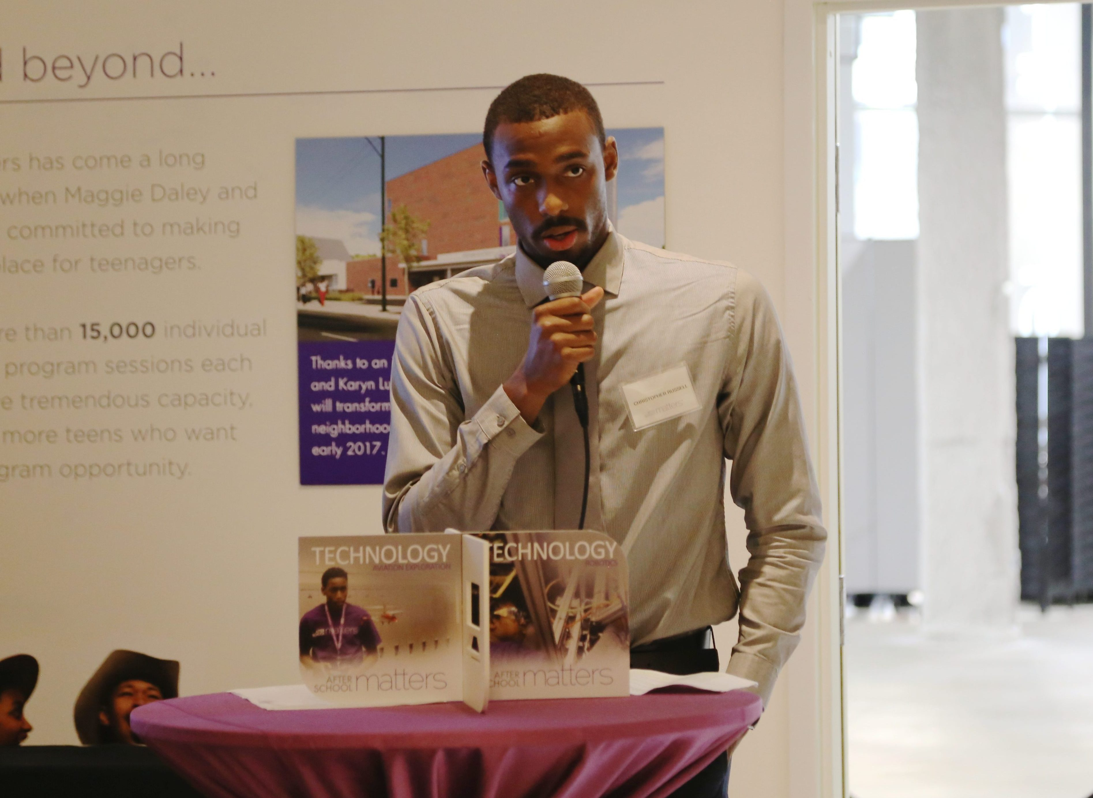 Alumnus Christopher Russel speaking about his program experience at an After School Matters event.