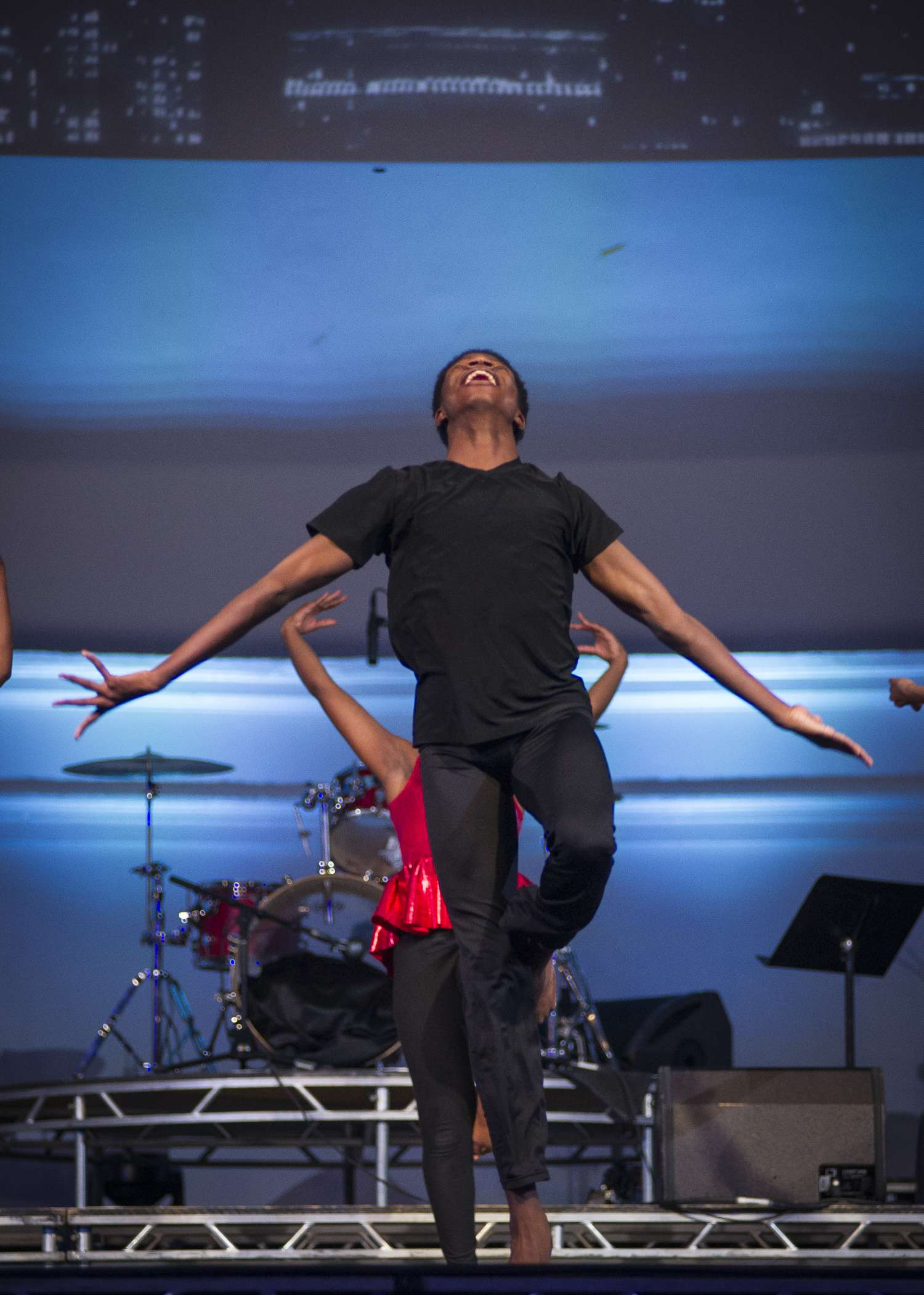 <p>Teen Isaiah D. dances a jazz piece he choreographed with the After School Matters Dance Ensemble at Navy Pier's Aon Grand Ballroom on September 19, 2016. Photo credit: John Martin-Eatinger</p>