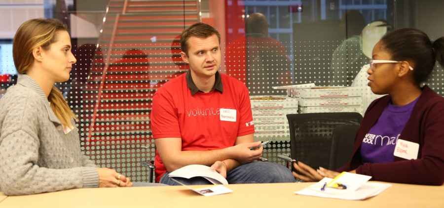 Teen Myia participates in a mock interview with two Morningstar employees.