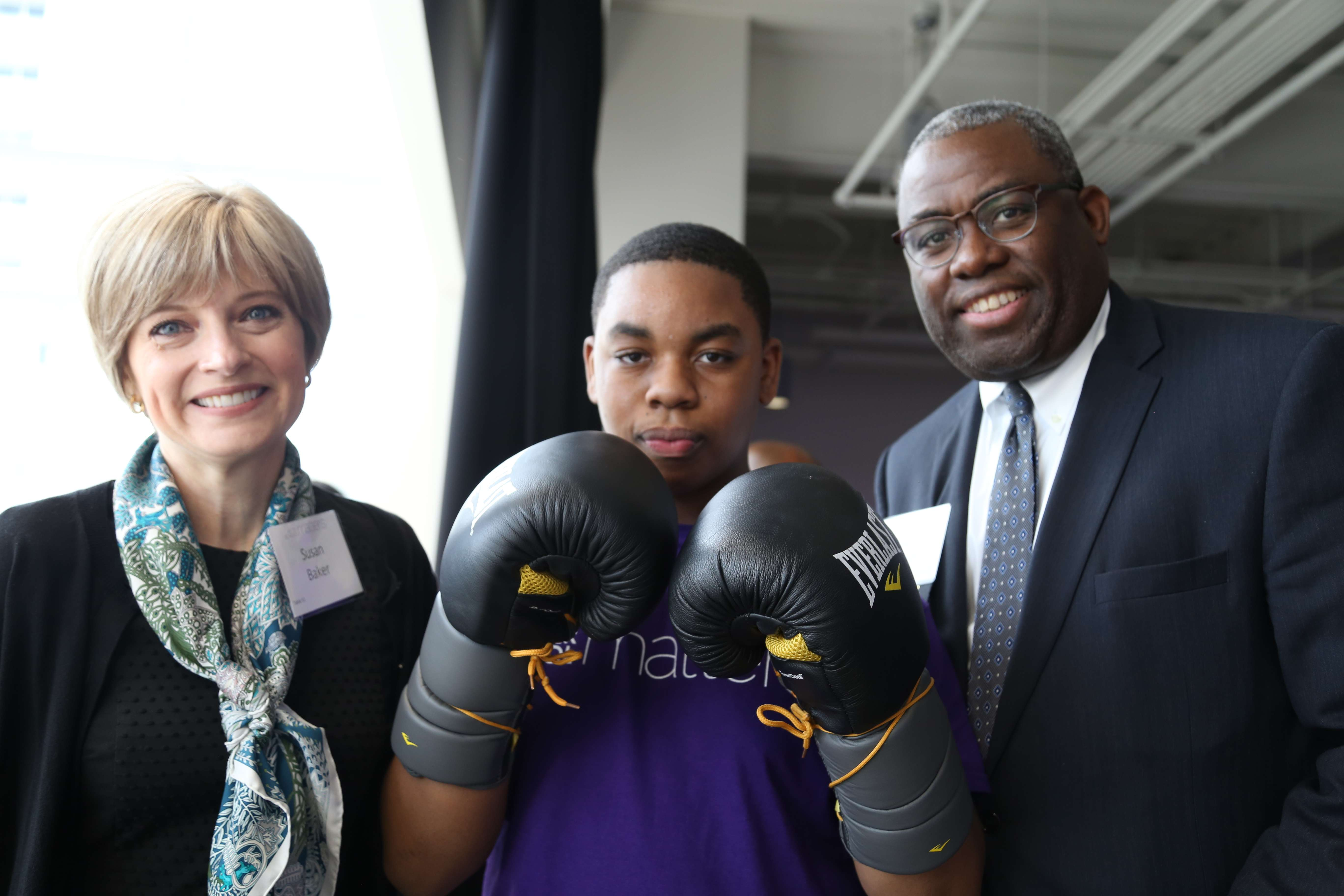 <p>Kashim Skeete, After School Matters Board member, and Susan Baker meet a teen from the Art of Boxing program during the After School Matters Annual Gala on September 18, 2017 at Wintrust Arena. Photo credit: After School Matters </p>