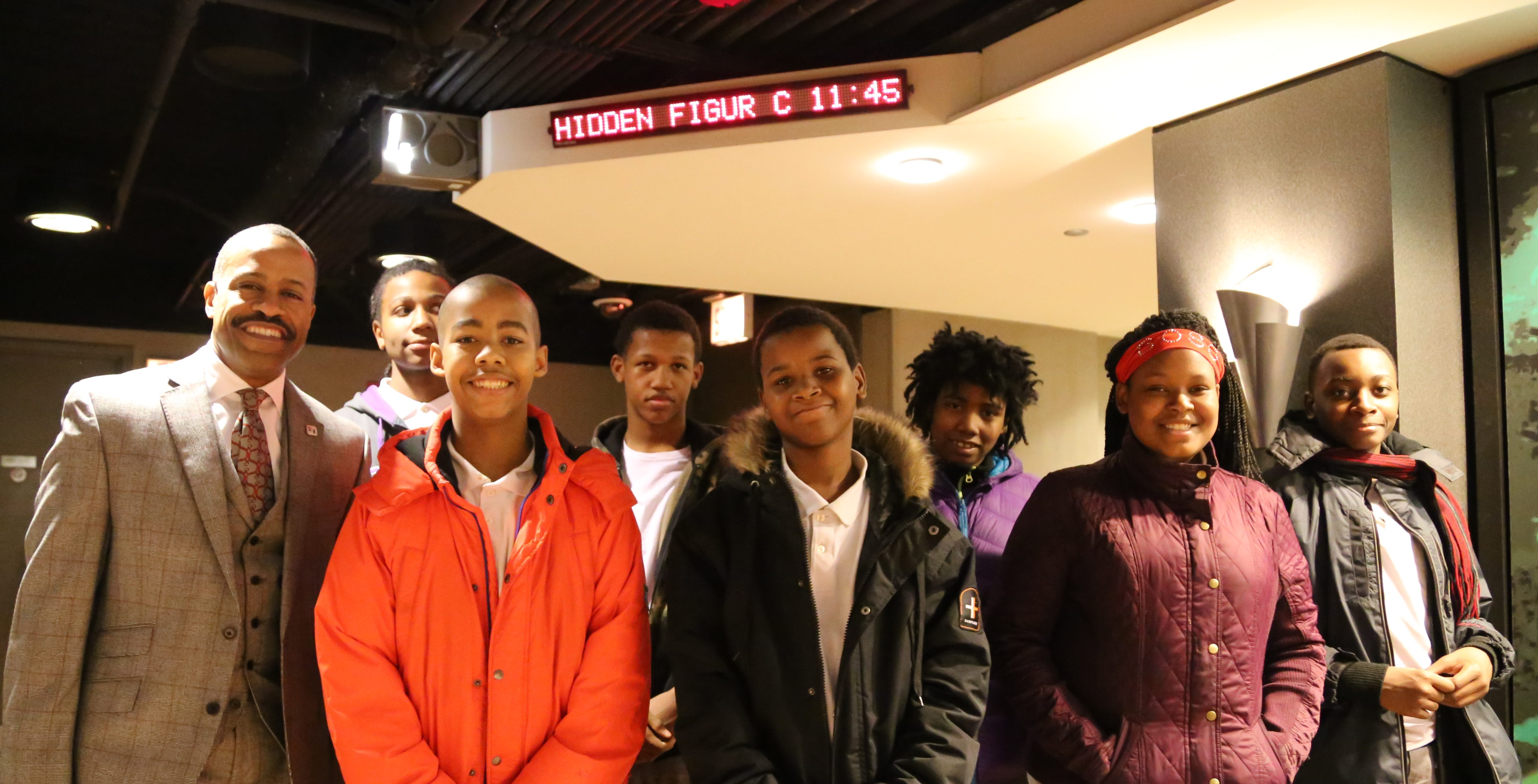 Image: Fifth Third Bank's Market President Eric S. Smith stands with a group of seven youth outside the theater, before the screening.