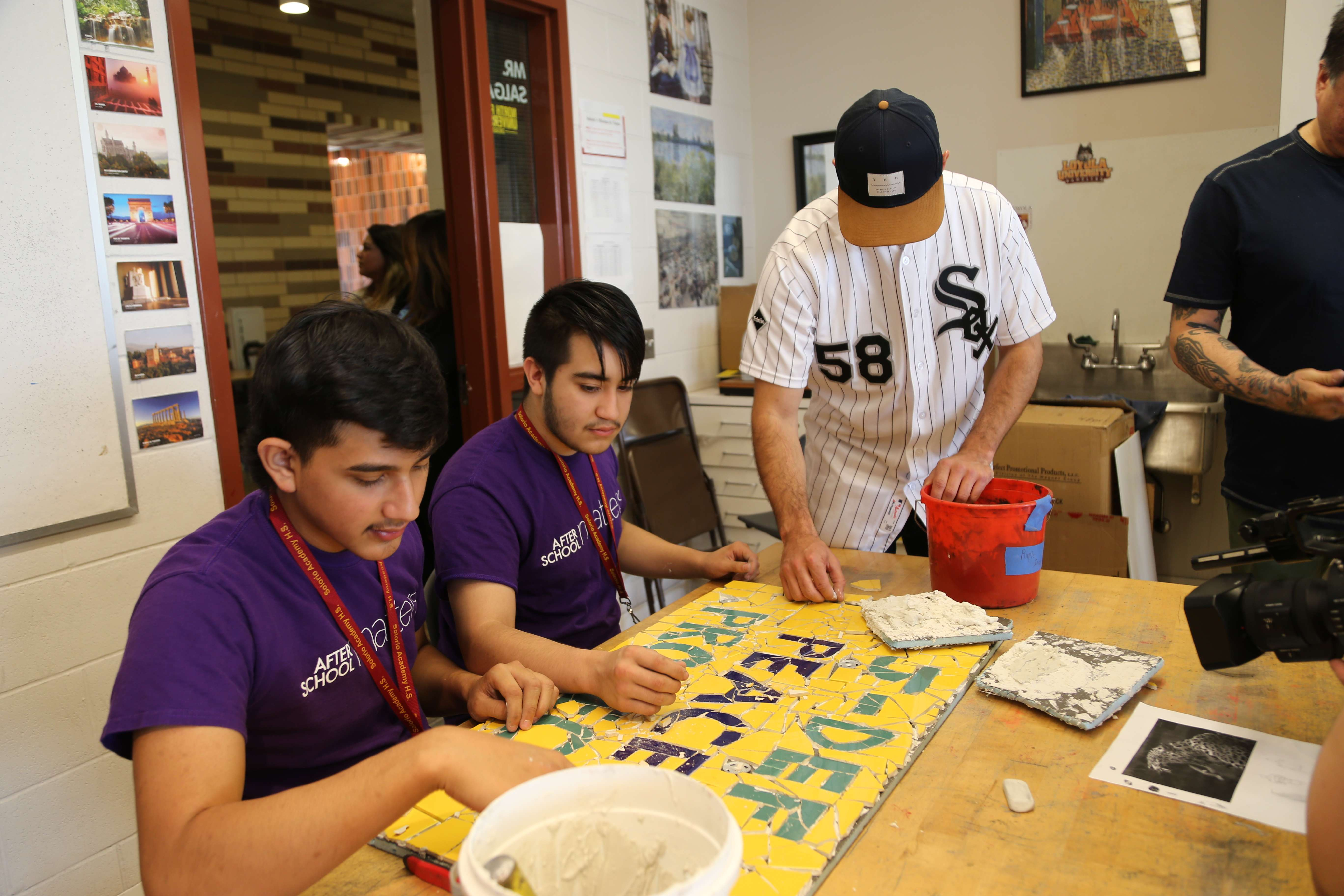Gonzalez helps piece together a mosaic with the name of the program.