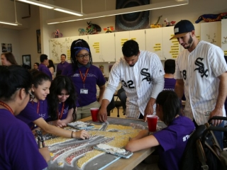 Teens work with May and Gonzalez to create one of the glass mosaics.