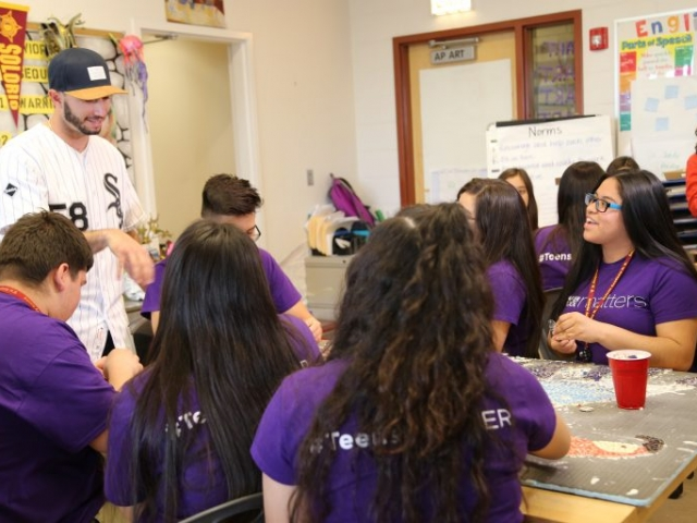 Gonzalez speaks with a group of After School Matters teens in the J-Def program at Solorio Academy High School.