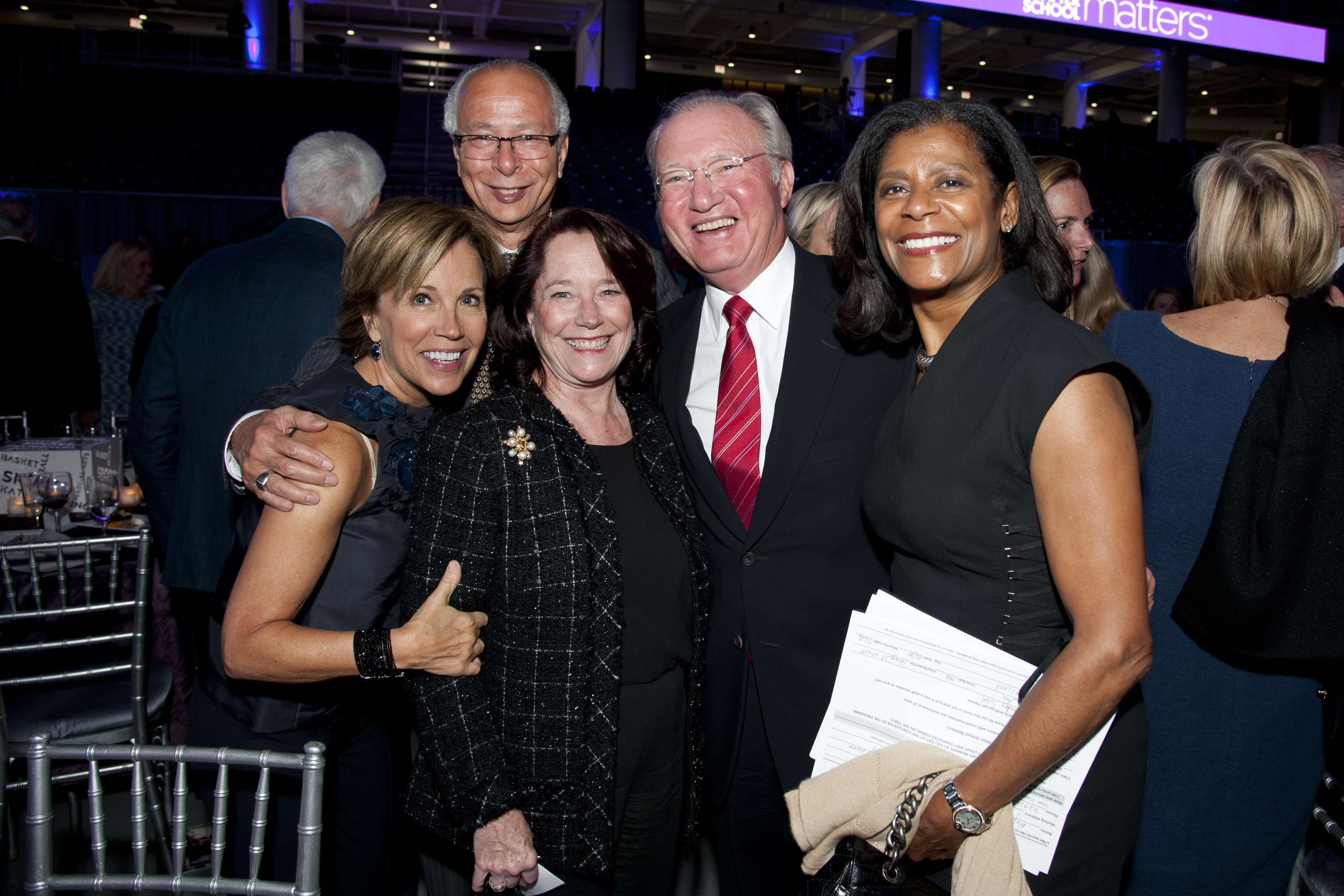 <p>Youth supporters Bernie Keller, Sam Scott, Jackie Tilton, Glenn Tilton and Dona Scott pose on the arena floor of Wintrust Arena after an evening of youth performances at After School Matters Annual Gala on September 18, 2017. Photo credit: Robert Carl</p>